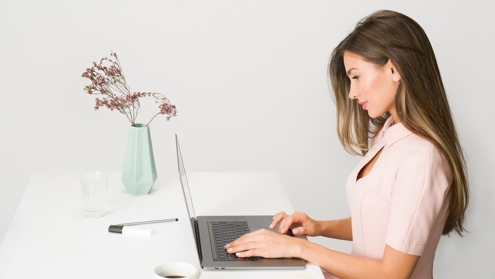 A Woman working in her home office after finding tips for staying busy